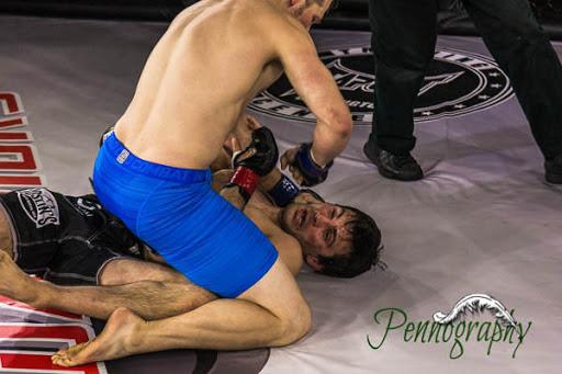 Global Warrior F.C. 2, Ryan Dickson vs Jason Witt at Burlington Central Arena in Burlington, Ontario on May 30, 2015. Photo: Jeremy Penn / Pennography  NIKON D7100 AF Zoom 17-55mm f/2.8G 1/500, f/2.8 ISO: 1600