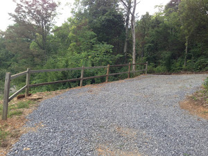 The completed fence along our driveway.