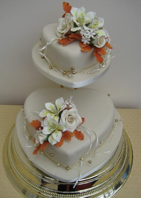 Two Tier Heart Shaped Wedding Cake With Flowers Wedding