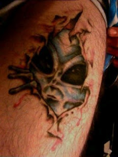 3d tattoo: a green alien head