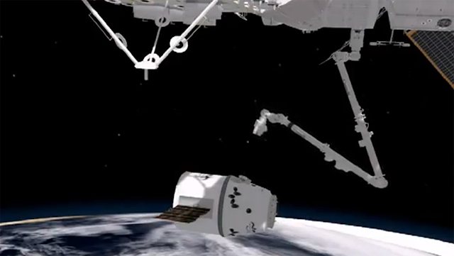 Canadarm2 Grabbing SpaceX Dragon Module