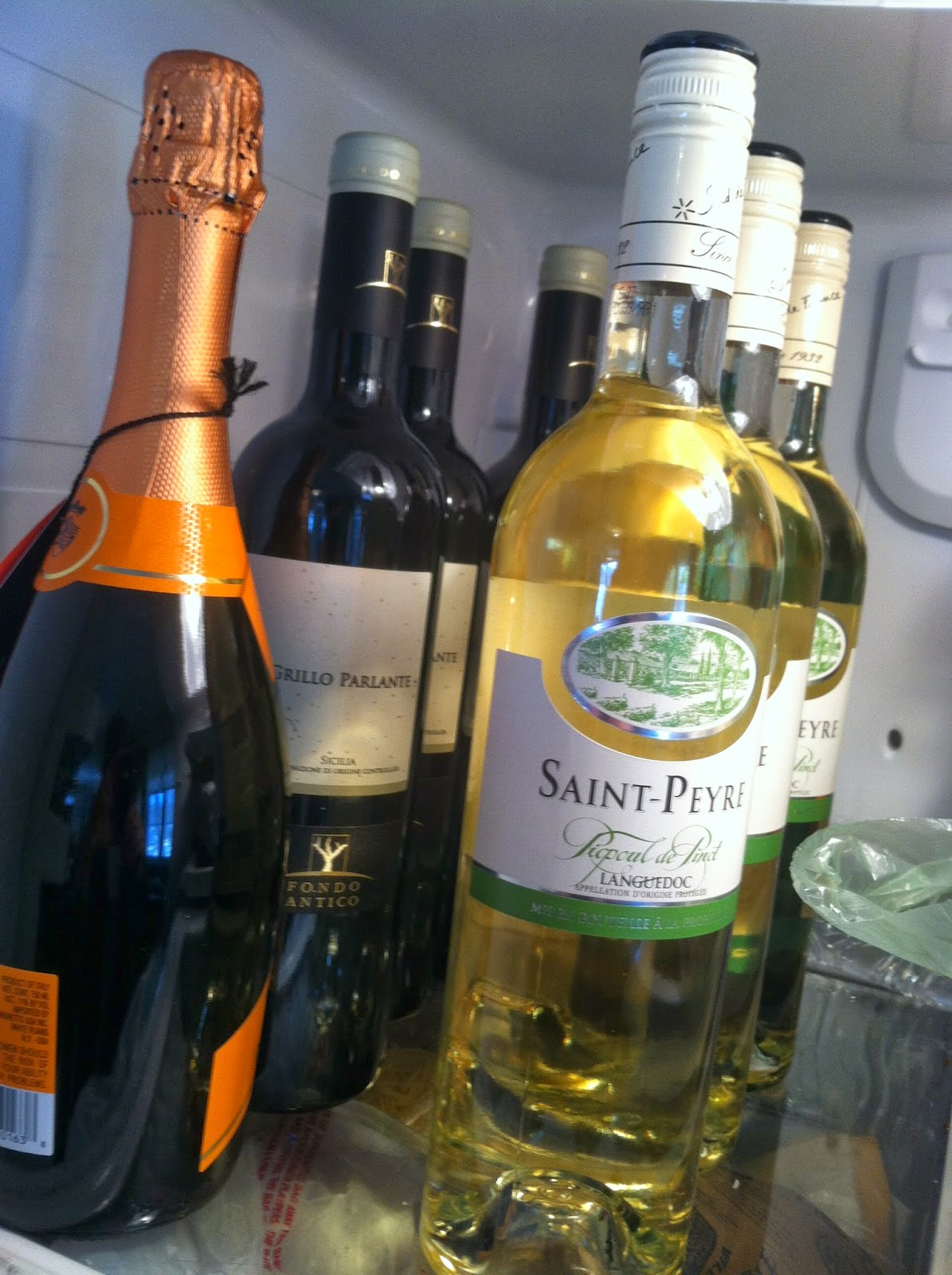 Interesting white wines: Picpoul-de-Pinet and Grillo, chilling for a party. #wine