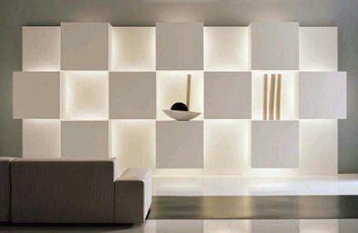 bello estante de diseo minimalista hecho en base a cuadrados en algo y bajo relieve todos de color blanco lo que agrega luz al espacio with estantes