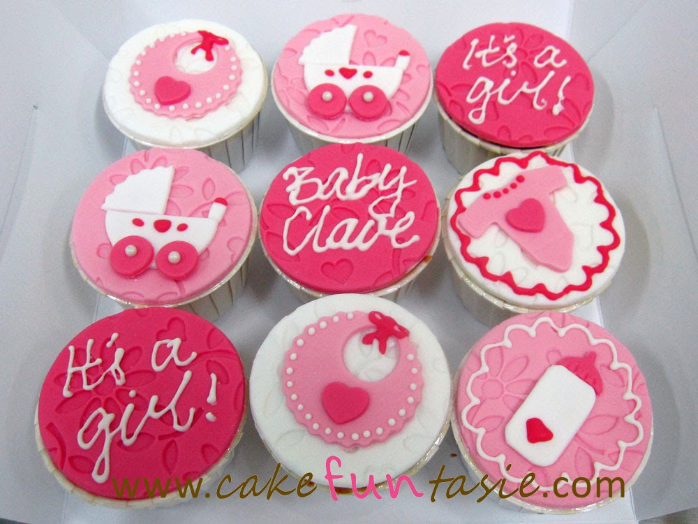 baby shower cupcakes differing shades of hot pink and sweet pink for