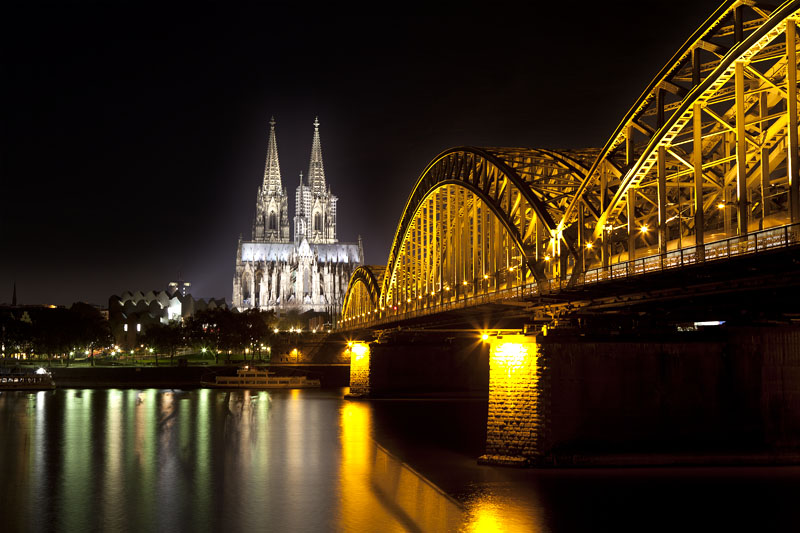 Cologne cathedral by night river bridge