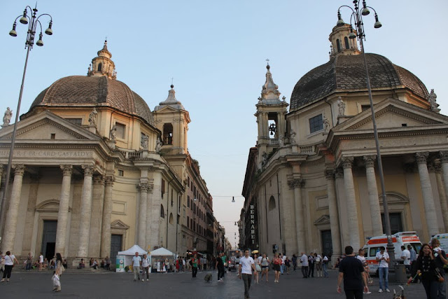 Two symmetrical churchese of Santa Maria dei Miracoli and Santa Maria in Montesanto in Piazza del Popolo in Rome, Italy