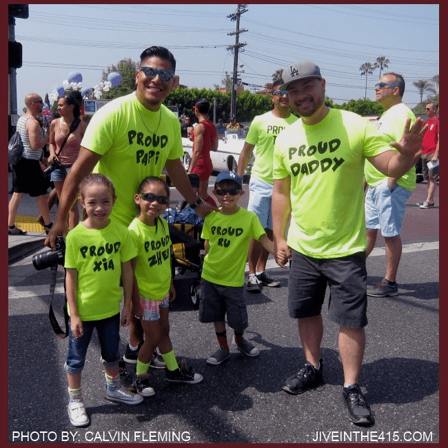 Two gay Daddies with their three kids at L.A. LGBT Pride Parade 2014
