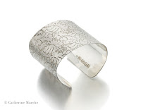 http://shop.catherinemarche-designs.com/collections/volutes/products/volutes-photo-etched-sterling-silver-cuff-bracelet-with-floral-pattern--2