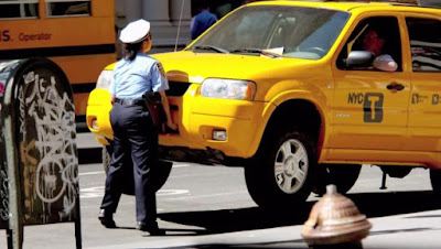 The lady cop gets her revenge on a rude cab driver