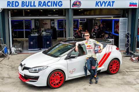 Daniil Kvyat poses with the Renault Megane RS 275 Trophy-R