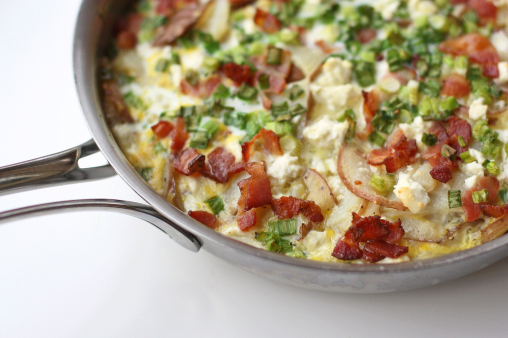 This is the BEST frittata, packed with potatoes, feta, and bacon. Perfect for any time of day.