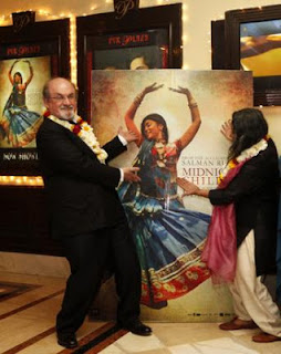 Rushdie and Deepa Mehta Dancing in front of film poster