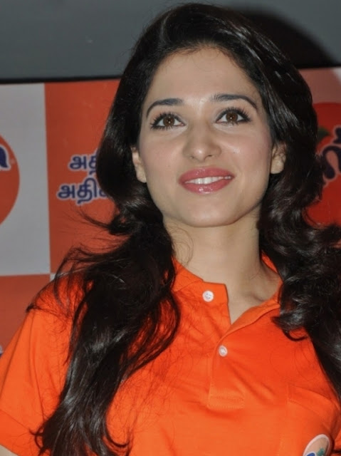 Tamanna Stills in Orange T-Shirt at Fanta Event