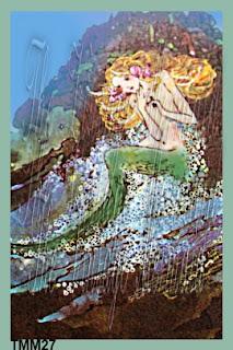 teenager mermaid in deep thought on rocks by vintagemermaidsfabricblocks.com