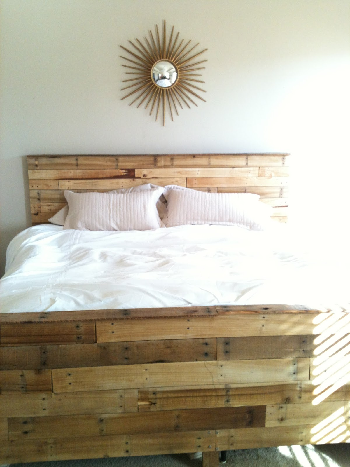 playing house: So, we made our bed out of pallets.