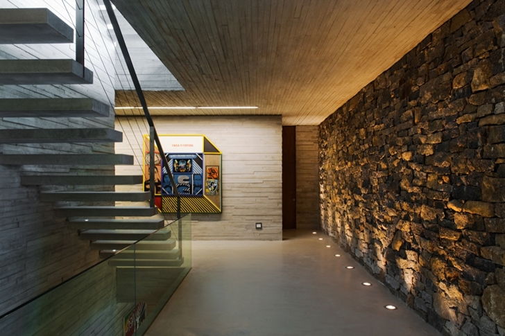 Stone wall and stairs in Modern beach house in Brazil by Marcio Kogan