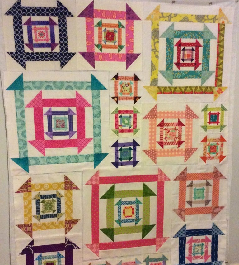 Nested Churn Dash scrappy quilt