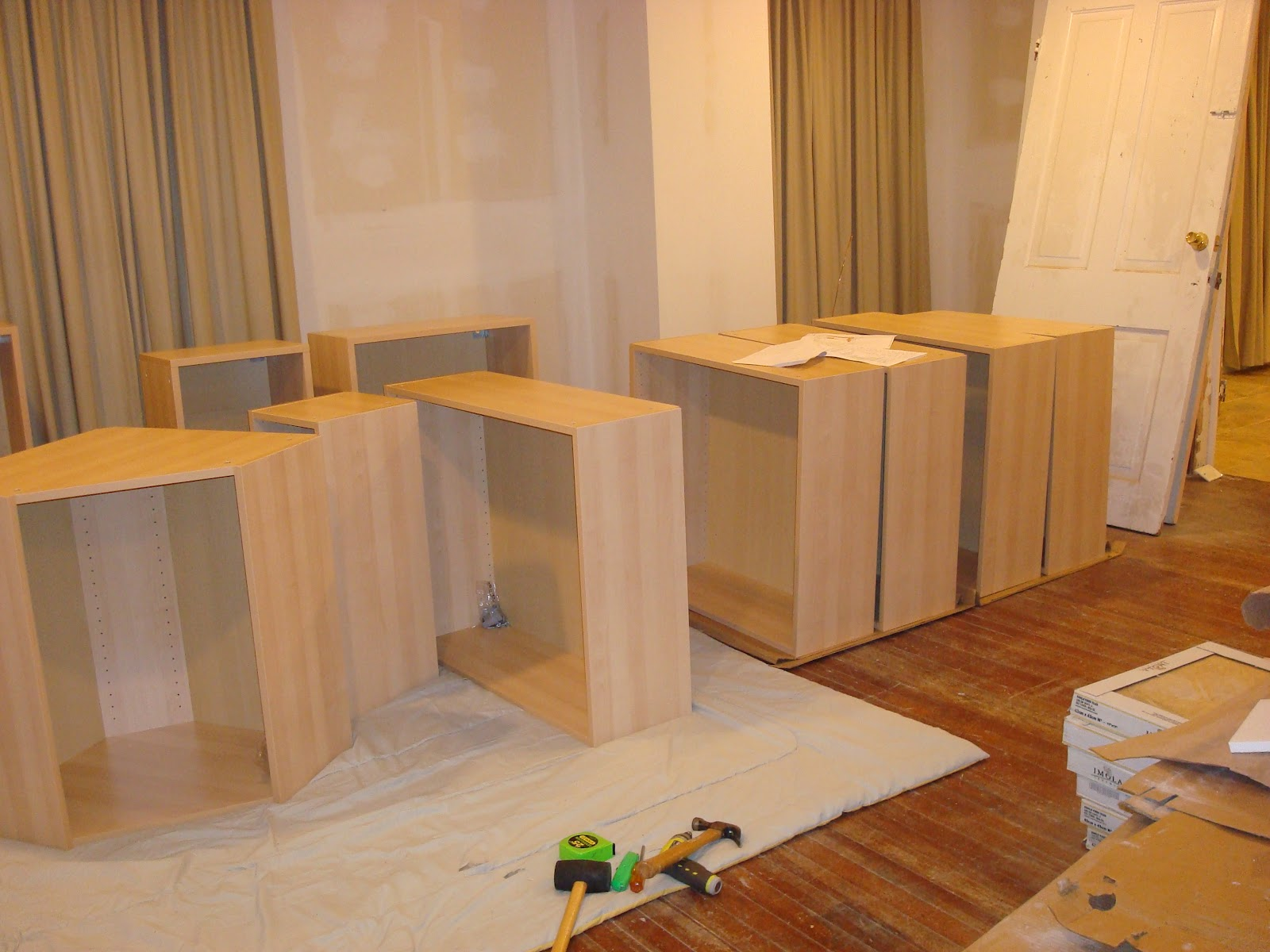 Building An Island With Ikea Cabinets ~ The rail is installed on the walls to hand the upper cabinets