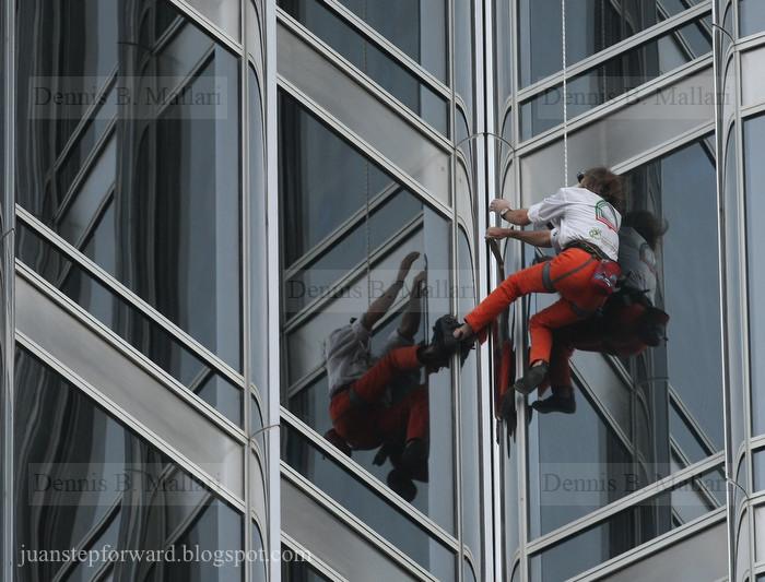 Dennis b mallari french spiderman alain robert scales burj khalifa march - Alain robert burj khalifa ...