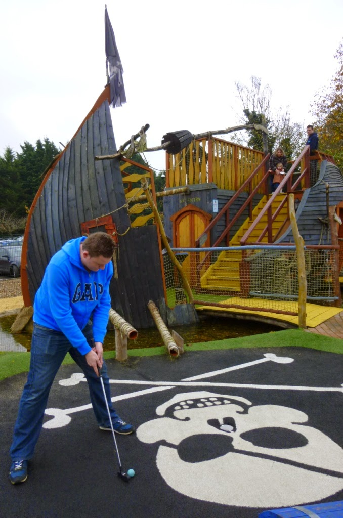 Minigolf Champion Matt Dodd putting during the Surrey Invitational Tournament round at Pirate Island Adventure Golf at Hoebridge Golf Centre in Woking