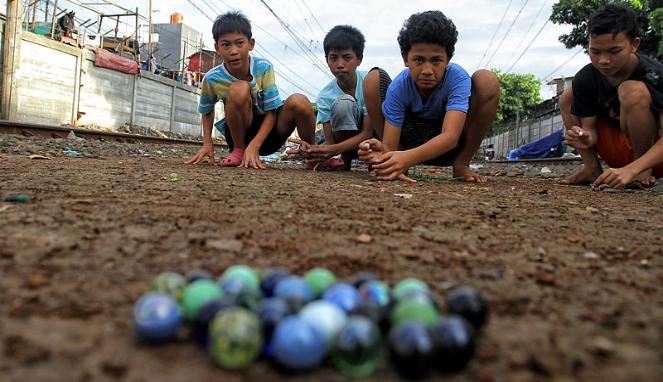 Permainan Tradisional Melayu Guli Riau Berbagi