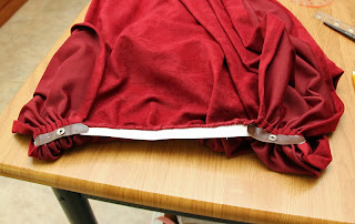 Lord Elrond cape with elastic and snaps.