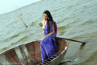 Nikitha Narayan wearing Saree in a River Spicy Pictures from Its My Love Story