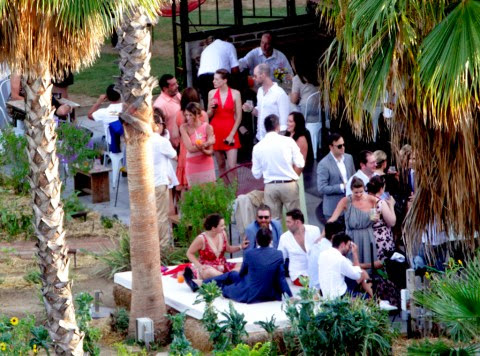 a stolen shot of guests gathering in wedding venue