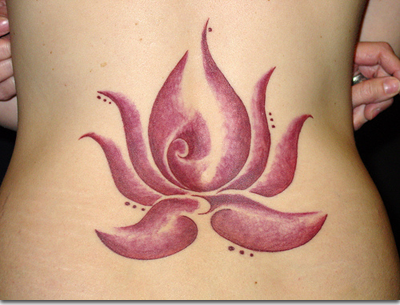 Tattoos change lotus flower tattoo pictures for Cute lower back tattoos tumblr