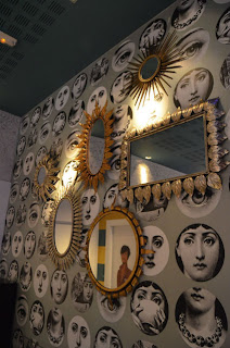 Combinations of small mirrors or asymmetric mirrors unusually small or large seek to attract attention