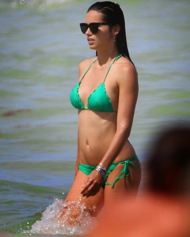 In tip top shape, the supermodel looks sensational in her green bikini body, showing off her incredible beauty anatomy and wonderful stomach during her break in Miami, FL, USA on Sunday, June 15, 2014.