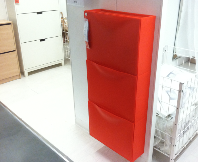 After the rooms tour, they showed this orange wall-mounted clothing cabinet  and described - Wall Mounted File Cabinet Cymun Designs