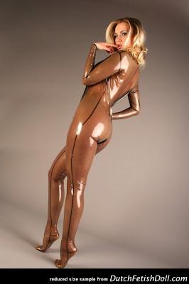 Fetish Doll Ancilla Tilla Posing in Latex Catsuit