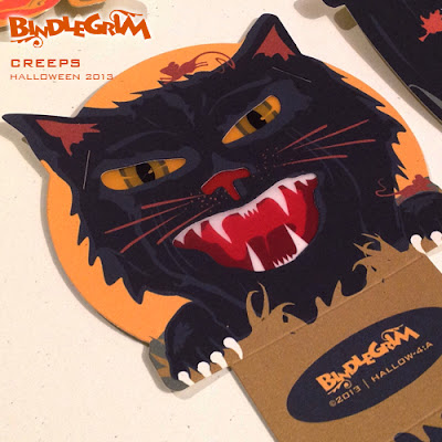 Close up of diecut by Bindelgrim - this black cat is  vintage style slot and tab candy container lantern with vellum eyes