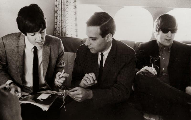 Paul McCartney, Larry Kane and John Lennon in 1964