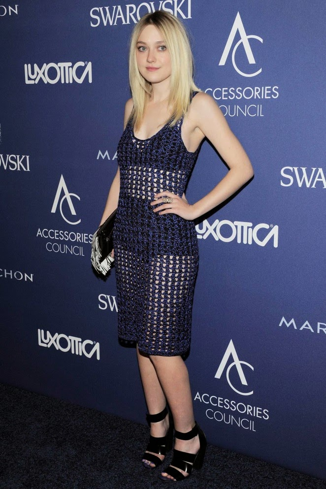 Dakota Fanning wears a blue crochet dress to the 2014 Accessories Council ACE Awards in NY