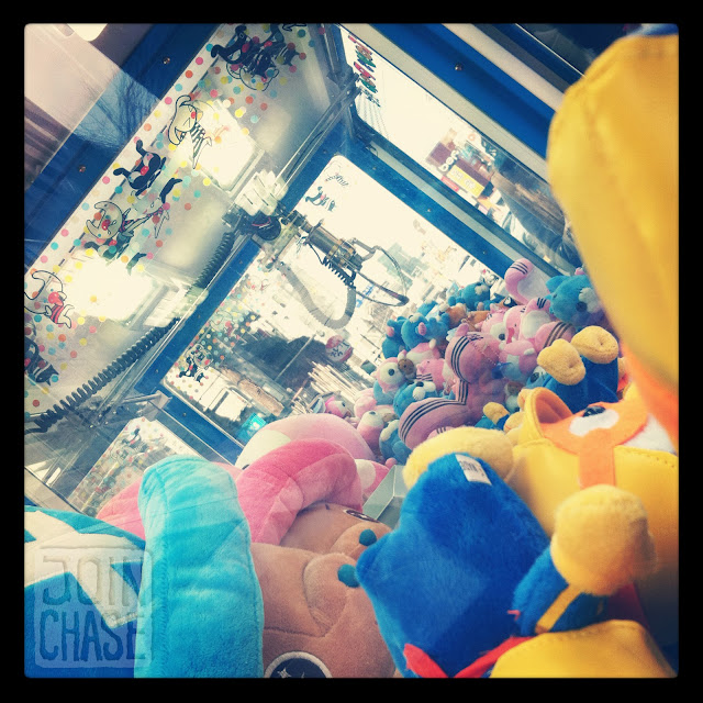 A claw machine filled with stuffed animals in Hongdae, Seoul, South Korea.