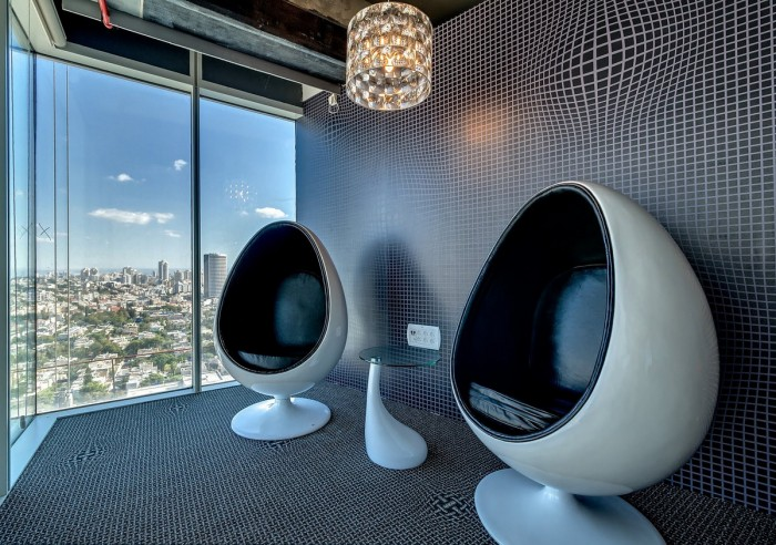 Picture of two egg chairs in the office 