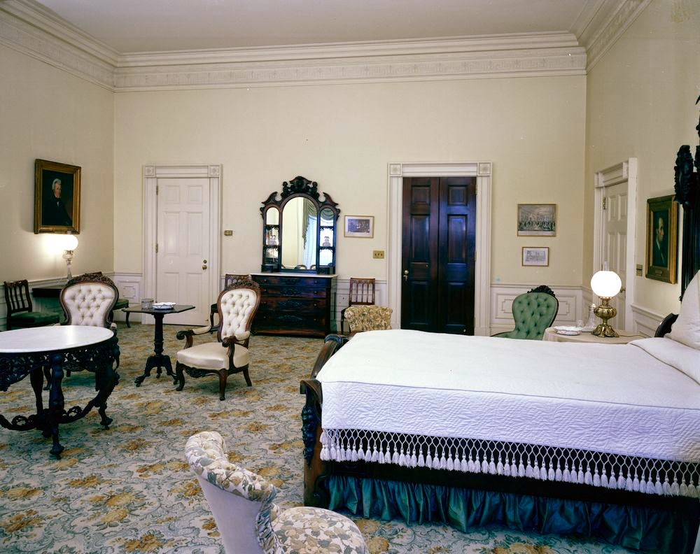 View of the Lincoln Bedroom  White House  Washington  D C  Portraits of  Abraham Lincoln  far right  and Andrew Jackson  left  hang on wall. View of President John F  Kennedy s Rooms  White House in 1962