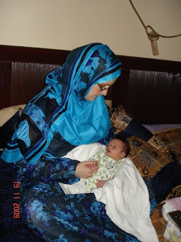 Qahtan & I when he was 4 days old in Buraimi, Oman.