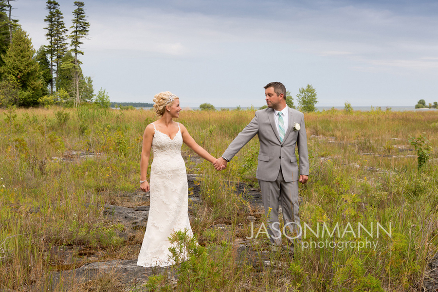 Rustic nature surrounds this bride and groom. Door County wedding. Gordon Lodge. Photo by Jason Mann Photography, 920-246-8106, www.jmannphoto.com