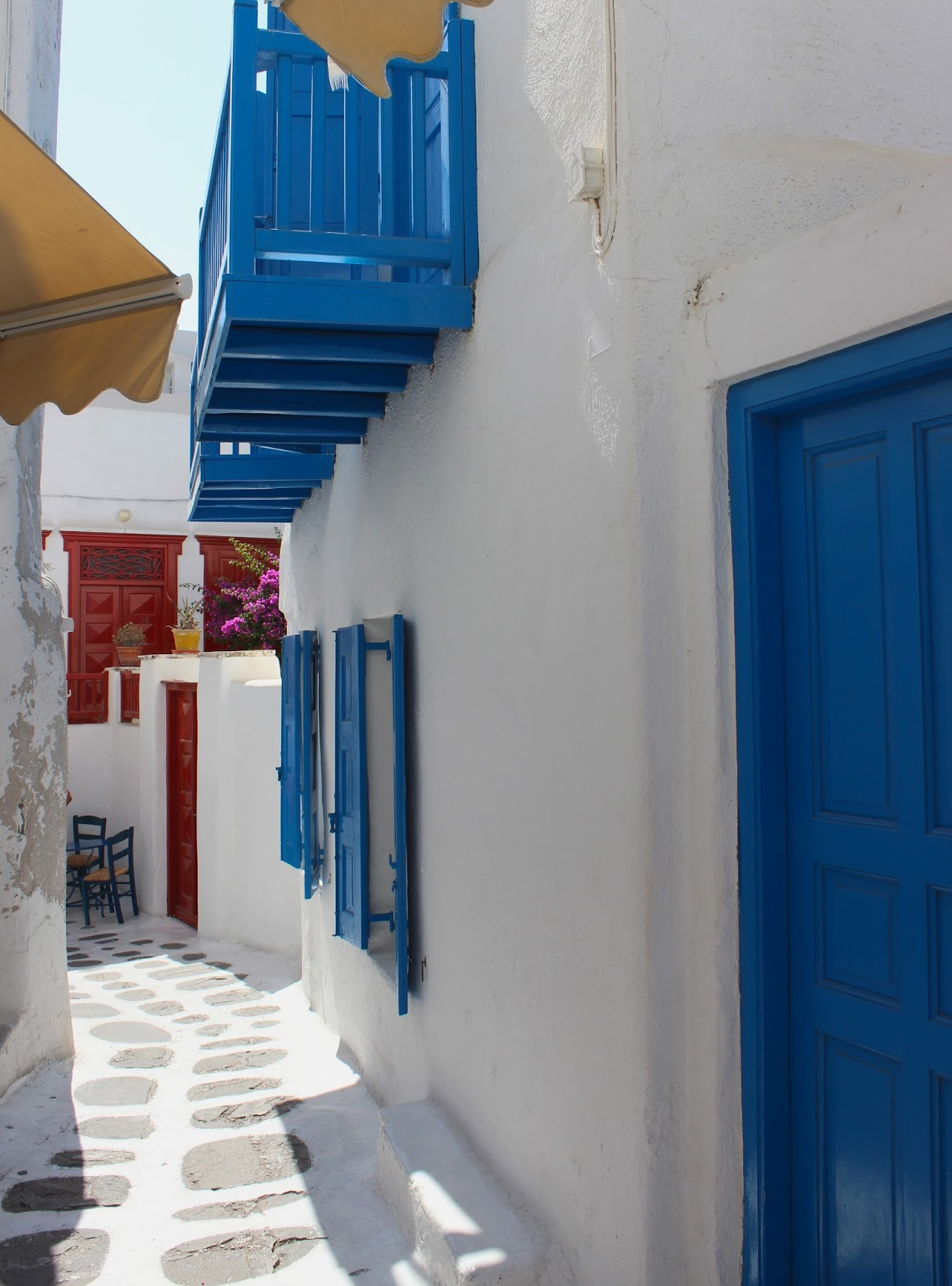 Mykonos White washed building blue shutters
