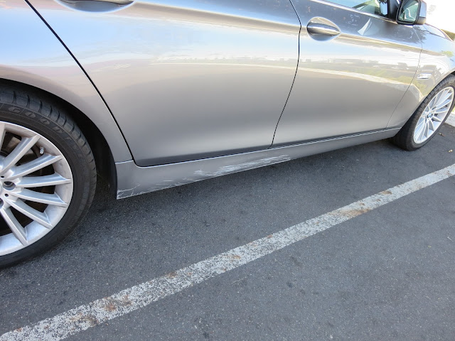 BMW with nasty scrape on rocker panel before repairs at Almost Everything Auto Body