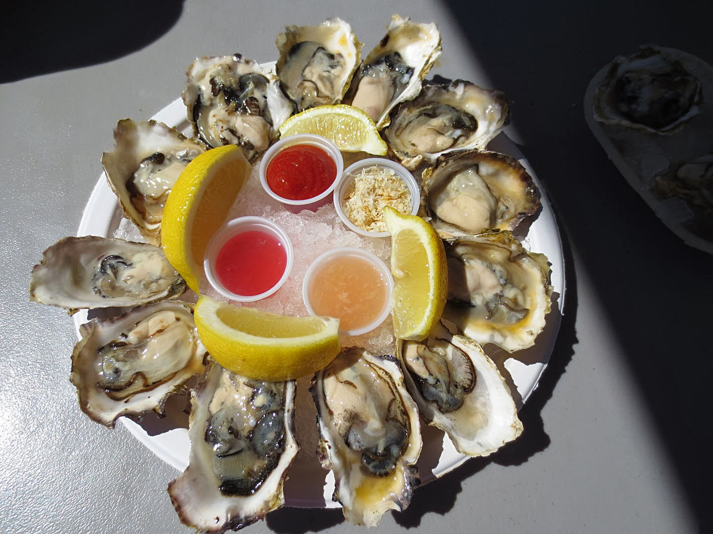 Raw oysters served with 3 types of vinaigrette, horseradish, and lemons