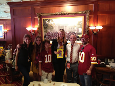 Tanya Snyder and family in Redskins owner's box with Benjamin Rubenstein