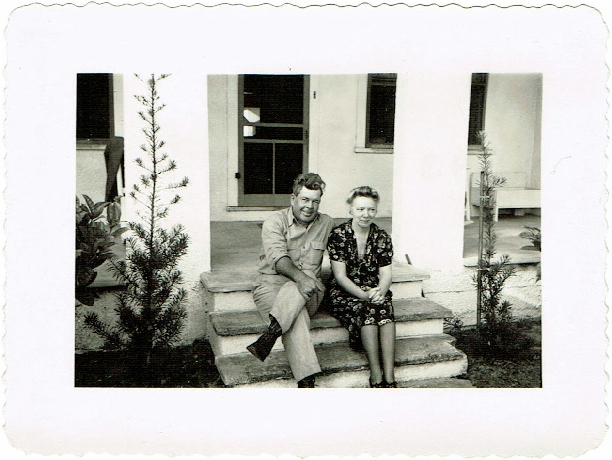Reubin Childers and Aina T Persson Childers sitting in front of their home in Fort Meade Florida