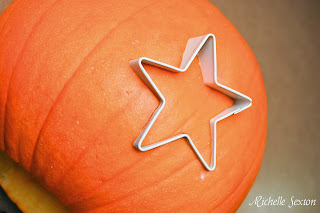 star cookie cutter pressed into pumpkin