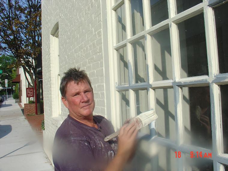 Richie painting exterior windows of retail shop, Long Island NY.JPG