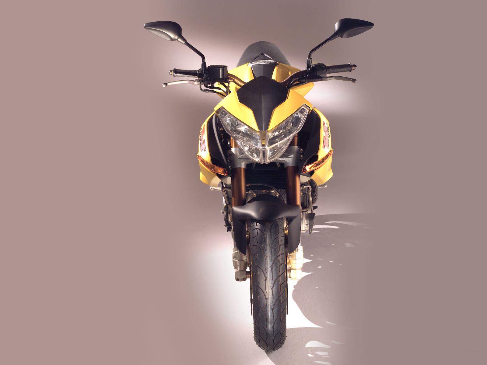 http://1.bp.blogspot.com/-t38mf1wd3P4/Tr28zUniJtI/AAAAAAAADww/FIRobkNgi4I/s1600/2005_Benelli-TNT-1130_motorcycle-desktop-wallpaper_05.jpg