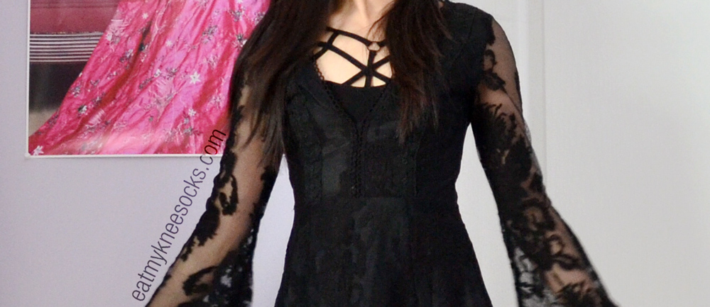 SheInside's dupe of the Free People Reign Over Me lace dress features a deep v-neck and embroidered overlay,